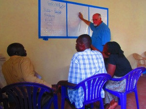 Training my translators. They speak Japadola here, so Alfred cannot help with the translation. He is enjoying being a student for a change.